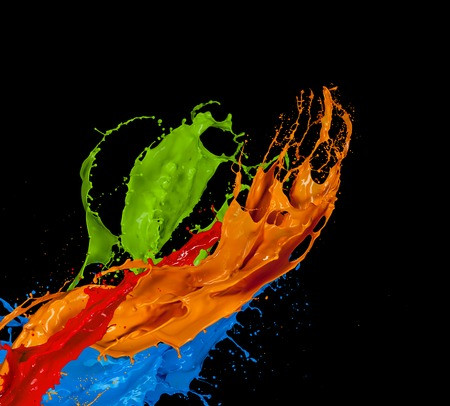 to paint colorful: Colored paint splash isolated on black background