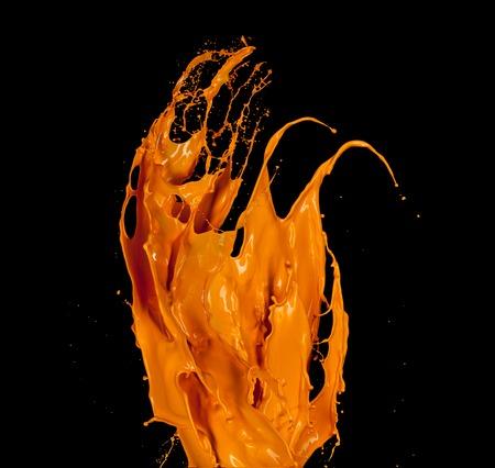 paint splash: Orange paint splash isolated on black background