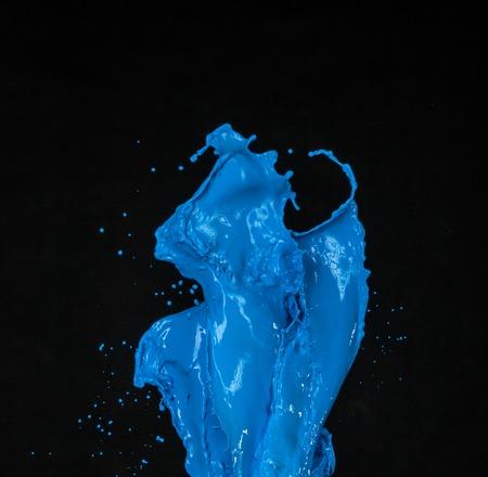 paint splash: blue paint splash isolated on black background