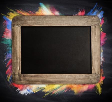 colored powder: Empty blackboard with colored powder Stock Photo