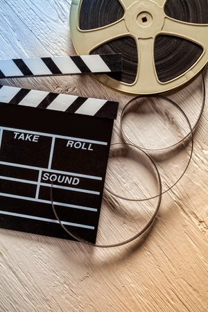 cinema film: Film camera chalkboard and roll on wooden table