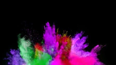 colored powder: Isolated shot of abstract colored powder shape on black background