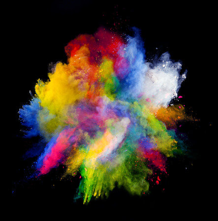 explode: Isolated shot of abstract colored powder shape on black background