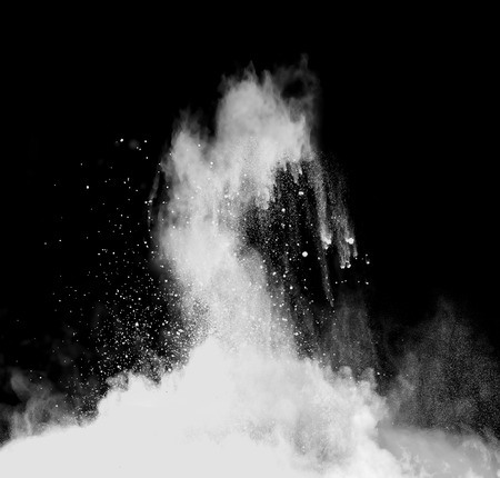 Isolated shot of white powder on black background