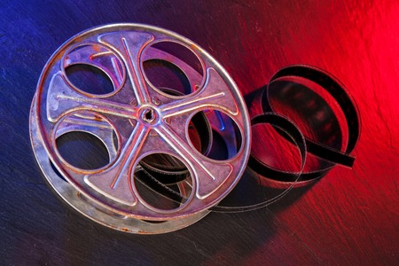 celluloid film: Old motion picture film reel on dark background