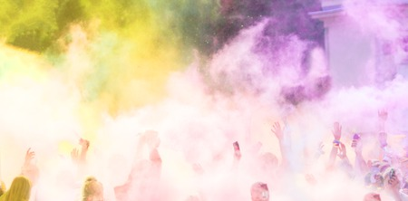 colored powder: Close-up of marathon runners with colored powder in the air
