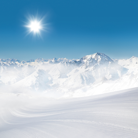 Alps  panorama view in winter snow time with ski slope 스톡 콘텐츠