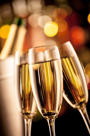bubbly: Glasses of champagne in holiday setting, served on bar counter