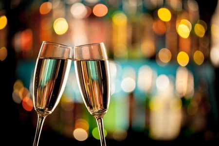champagne: Glasses of champagne in holiday setting, served on bar counter