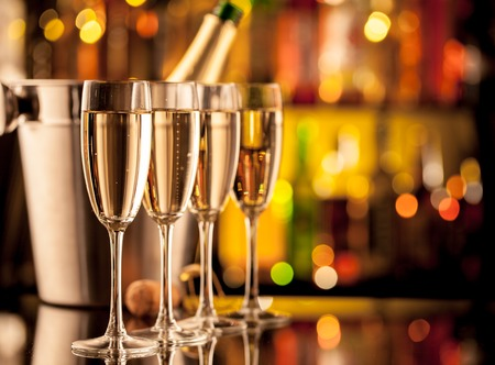 new years eve party: Glasses of champagne in holiday setting, served on bar counter