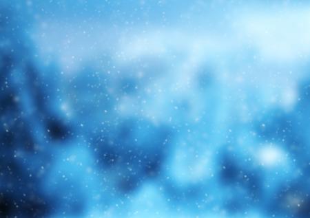 落ちてくる雪の結晶を持つ抽象冬背景をぼかし