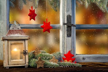 Lantern on window sill in winter mood