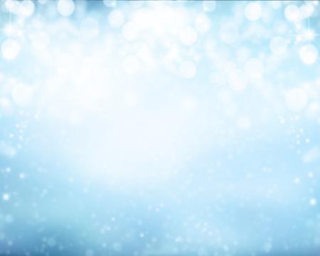 fondos azules: desenfoque de fondo de invierno cubierto de nieve abstracto con focos Foto de archivo