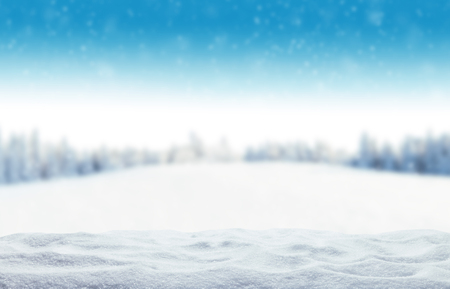 and in winter: Winter background with pile of snow and blur landscape. Copyspace for text
