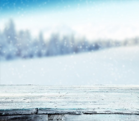 background wood: Winter background with pile of snow and blur landscape. Empty wooden planks on foreground. Copyspace for text Stock Photo