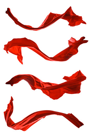 dynamic movement: Isolated shots of freeze motion of red satin, isolated on white background Stock Photo
