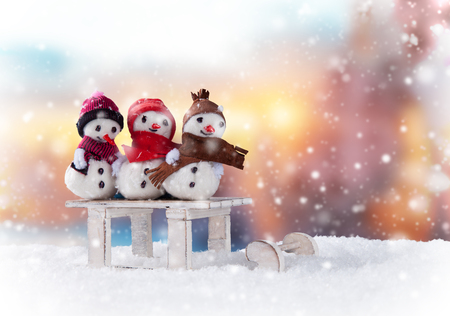 frosty the snowman: Christmas still life background with snowmen on sledge