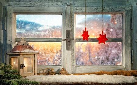 windows: Atmospheric Christmas window sill decoration with beautiful sunset view Stock Photo