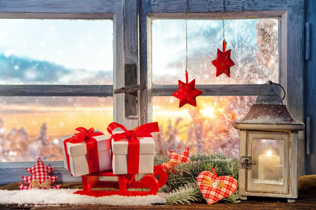Atmospheric Christmas window sill decoration with beautiful sunset view Stock Photo