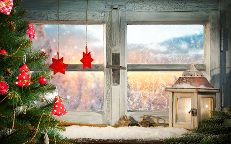 decoration: Atmospheric Christmas window sill decoration with beautiful sunset view Stock Photo