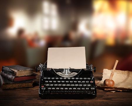 office life: Antique typewriter in retro office. Vintage still life Stock Photo