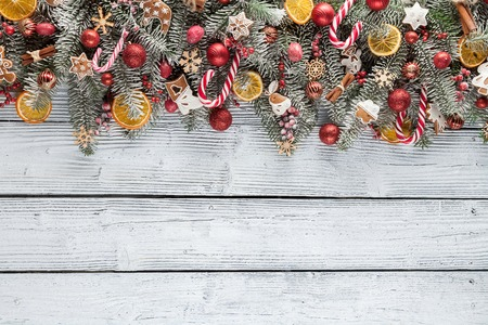 evergreen: Christmas fir tree with decoration on a wooden board. Copyspace for text Stock Photo