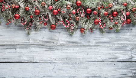 shiny gold: Christmas fir tree with decoration on a wooden board. Copyspace for text Stock Photo
