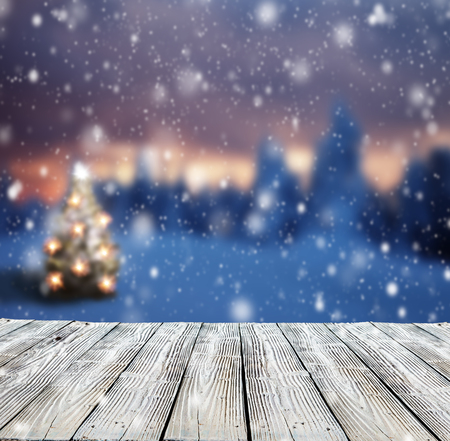 scene: Winter background with mole and blur evening landscape. Empty wooden planks on foreground. Copyspace for text