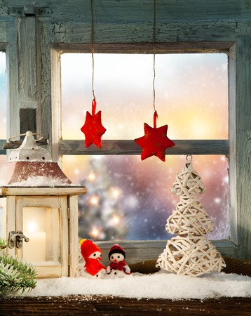 winter window: Atmospheric Christmas window sill decoration with beautiful evening view outside
