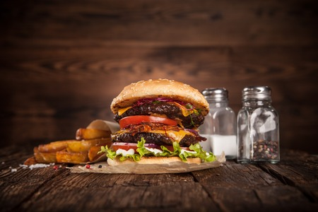 Delicious hamburger served on wooden planks Stock Photo - 47420826