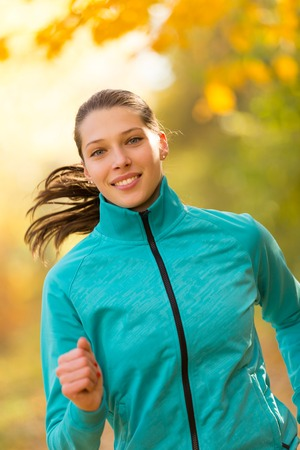 woman sunset: Female fitness model training outside and running. Sport and healthy lifestyle