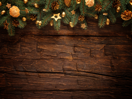 Christmas fir tree with decoration on a wooden board. Free space for text