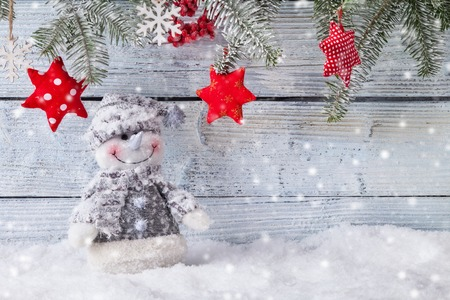 frosty the snowman: Christmas still life background with snowman on wooden background Stock Photo