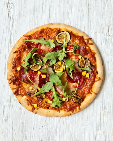 food ingredient: Delicious italian pizza served on wooden table, shot from above