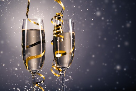 Pair glass of champagne. New Year celebration theme with blur spots of bubbles
