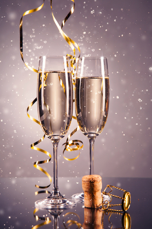 celebration background: Pair glass of champagne. New Year celebration theme with blur spots of bubbles