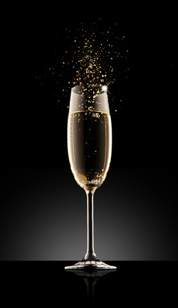champagne party: Glass of champagne, isolated on a black background.