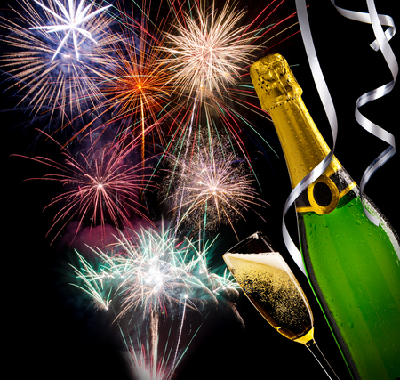 unopened: Glass of champagne with unopened bottle with fireworks on background Stock Photo
