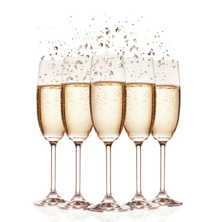 Glasses of champagne with bubbles, isolated on white background Stockfoto