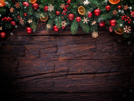 aged wood: Christmas fir tree with decoration on a wooden board. Copyspace for text Stock Photo