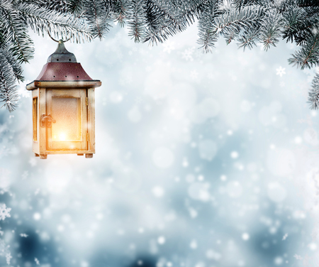 Christmas lantern hanging on fir branches. Copyspace for text Stock Photo