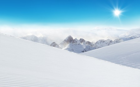 piste: Winter Alpine snowy landscape with empty piste and mountain massive
