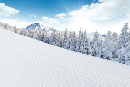 massive: Winter Alpine snowy landscape with empty piste and mountain massive