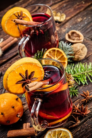 christmas tea: Hot wine drinks with spicy and sweet arrangement, Shot on old wooden table