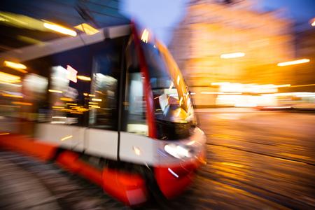 Modern tram in motion blur at night, Prague city, Europe.