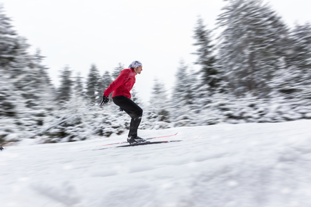 crosscountry: Cross-country skier. Young man cross-country skiing on winter day in motion blur movement