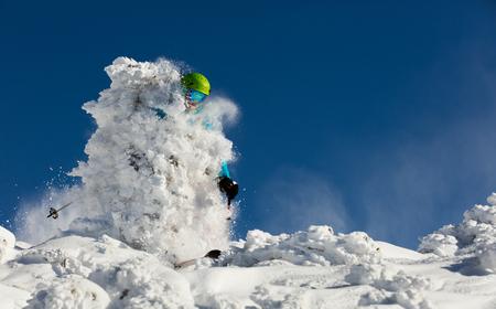 downhill: Man freeride skier running downhill on sunny Alps slope.