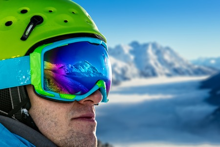 to ski: Portrait of happy young skier during sunny day. Panorama of Alps on background Stock Photo