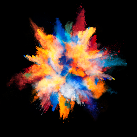 exploding: Explosion of colored powder, isolated on black background Stock Photo