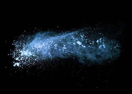 Explosion of blue powder, isolated on black background
